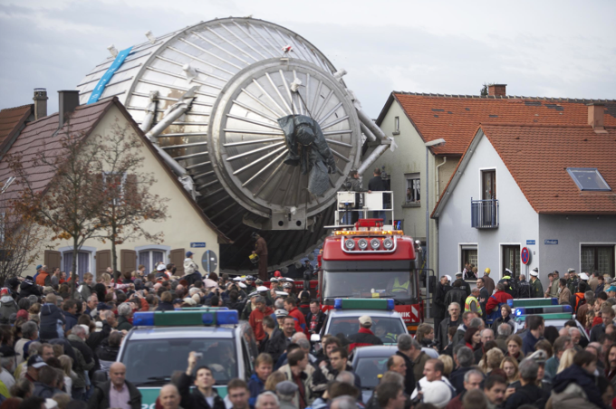 The KATRIN main spectrometer being transported through a small town in Germany. - Thumbnail